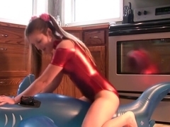 Megan loves to dress in her metallic leotard and grind on pool toys