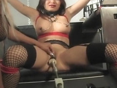 Hot Asian babe tortured with a fucking machine