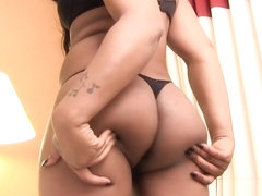 Curvy ebony ts teasing and tugging her cock