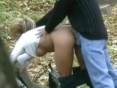 Very attractive blonde sucking dick and getting fucked doggystyle in the woods while being secretl.