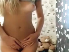 Blonde girl sticking her finger and squirting on her feet