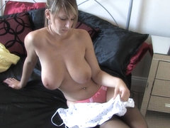Blonde hottie shows all in a topless down blouse video