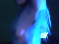 Hot Latina shaking her ass in blue light to techno music, twerking her ass