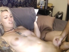 Inked Blond TS Getting A HJ By Her Male Guest