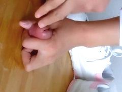 Chinese girl give a shoejob and footjob