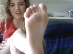 Sexy blonde talks dirty and teases with her feet