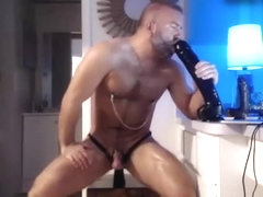 Brutal guy sits on a big dildo and gets pleasure
