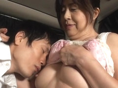 Mature Japanese AV model gives a hand job in the car