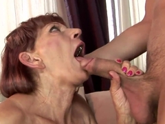 Nasty ginger granny Irene with disgusting swinging boobs is doing blowjob to her young tight dicke.