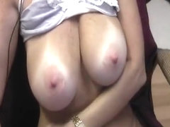 Busty tanline webcam girl is getting it on for the audience