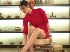 Chinese girl in traditional dress play feet with honey