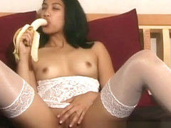 Mercy eats a banana while she sits spread-legged showing her cunt