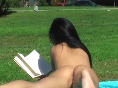 naked in public park sunbathing