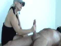 Dominant MILF with huge tits commands a large cock to during femdom handjob