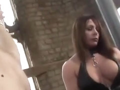 Hot mistress in latex spanks clumsy maid and drops hot wax on his big cock