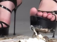 Dasha crush snails in high heels