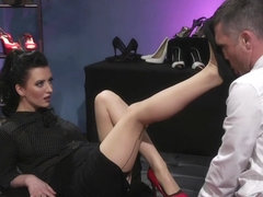 Feet lover dominated by brunette lady