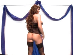 Buxom contestant in a beauty pageant dancing striptease at the talent competition