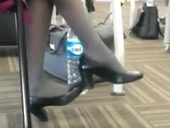Candid flight attendant dangling and shoeplay
