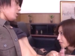 Asian milf in an office suit, Akari Asahina strokes horny guys cock
