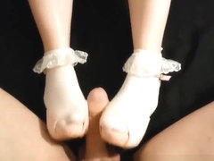 Young girl with perfect feet in frilly ankle socks and heels gives shoejob