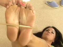 Two cute girls torture each other's feet with a cane and sharp bottle caps