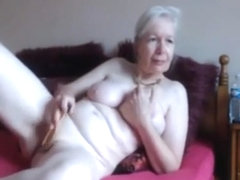 Lonely pale granny plays with toys on webcam and cums