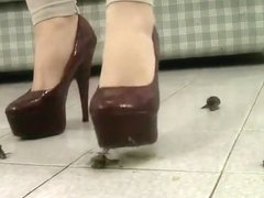 Snail crush with very high heels.